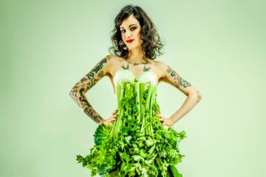 Young beautiful tattooed woman in a vegetable dress
